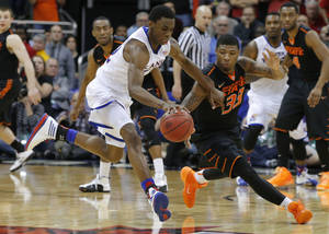 Photo - Oklahoma State's Marcus Smart (33) tries to steal the ball from Kansas' Andrew Wiggins (22) on Kansas' last possession of regulation in the Big 12 Tournament college basketball game between Oklahoma State University and Kansas at the Sprint Center in Kansas City, Mo., Thursday, March 13, 2014. Kansas won 77-70. Photo by Bryan Terry, The Oklahoman