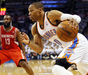 Photo - NBA BASKETBALL: Oklahoma City's Russell Westbrook (0) drives the ball in front of Houston's James Harden (13) in the second half during Game 2 in the first round of the NBA playoffs between the Oklahoma City Thunder and the Houston Rockets at Chesapeake Energy Arena in Oklahoma City, Wednesday, April 24, 2013. Oklahoma City won, 105-102. Photo by Nate Billings, The Oklahoman