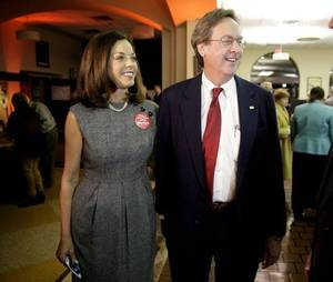 Photo - Mayor Dewey Bartlett and his wife Victoria arrive at his watch party Nov. 12, 2013. Mike Simons/Tulsa World