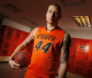 photo - COLLEGE BASKETBALL: OSU&#039;s Philip Jurick (44) poses for a photo during basketball media day for Oklahoma State University at Gallagher-Iba Arena in Stillwater, Okla., Monday, Oct. 22, 2012. Photo by Nate Billings, The Oklahoman