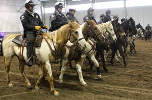 Photo - Oklahoma County deputies and their horses train March 2 at State Fair Park in Oklahoma City.  Photo By Paul Hellstern, The Oklahoman