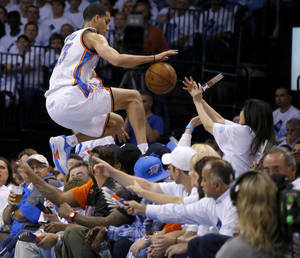 Photo - Oklahoma City's Kevin Martin (23) leaps into the crowd as he chases the ball during Game 5 in the second round of the NBA playoffs between the Oklahoma City Thunder and the Memphis Grizzlies at Chesapeake Energy Arena in Oklahoma City, Wednesday, May 15, 2013.  Photo by Bryan Terry, The Oklahoman