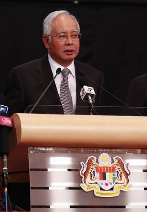 Photo - Malaysia's Prime Minister Najib Razak speaks during the press conference for the missing Malaysia Airline, MH370 at Putra World Trade Centre (PWTC) in Kuala Lumpur, Malaysia, Monday, March 24, 2014. (AP Photo/Vincent Thian)