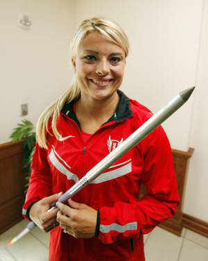 photo - Brittany Borman holds the Nemeth javelin on Thursday, July 5, 2012 in Norman, Okla. which she used on her final throw during the Olympic qualifiers.  Borman is among six athletes from the University of Oklahoma who have qualified for the 2012 London Olympics in track and field, wrestling and men's gymnastics.  Photo.  Photo by Steve Sisney, The Oklahoman <strong>STEVE SISNEY - THE OKLAHOMAN</strong>