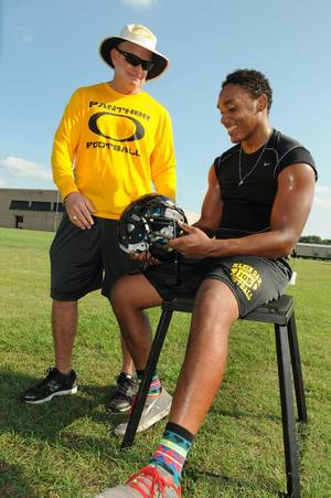 Photo - Klein Oak Head Football Coach David Smith, from left, chats with senior linebacker Josh Mabin during a team practice. PHOTO COURTESY HOUSTON CHRONICLE <strong>Jerry Baker</strong>
