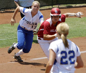 Photo - Tulsa's Jill Barrett runs down Oklahoma's Georgia Casey between third and home in the first inning of an NCAA softball regional at the OU softball complex in Norman, Okla., Saturday, May 19, 2012. Photo by Bryan Terry, The Oklahoman