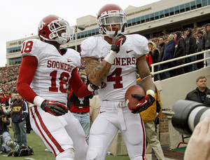 photo - Oklahoma&#039;s Kenny Stills (4) celebrates beside Oklahoma&#039;s Lacoltan Bester (18) after a touchdown during a college football game between the University of Oklahoma (OU) and Texas Tech University at Jones AT&amp;T Stadium in Lubbock, Texas, Saturday, Oct. 6, 2012. Oklahoma won 41-20. Photo by Bryan Terry, The Oklahoman