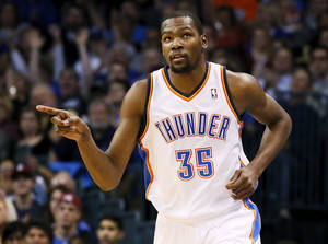 photo - REACTION: Oklahoma City's Kevin Durant (35) reacts after making a basket during an NBA basketball game between the Oklahoma City Thunder and the San Antonio Spurs in Oklahoma City Monday, Dec. 17, 2012. Photo by Nate Billings, The Oklahoman