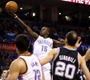 Photo - Oklahoma City's Reggie Jackson takes a shot during an NBA basketball game between the Oklahoma City Thunder and the San Antonio Spurs at Chesapeake Energy Arena in Oklahoma City, Wednesday, Nov. 27, 2013. Photo by Nate Billings, The Oklahoman