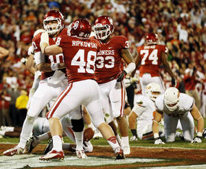 photo - BEDLAM FOOTBALL: Oklahoma's Blake Bell (10) celebrates with Aaron Ripkowski (48) and Trey Millard (33) after rushing for a touchdown in the final minute of regulation during the Bedlam college football game between the University of Oklahoma Sooners (OU) and the Oklahoma State University Cowboys (OSU) at Gaylord Family-Oklahoma Memorial Stadium in Norman, Okla., Saturday, Nov. 24, 2012. The extra point on this touchdown tied the game. OU won, 51-48 in overtime. Photo by Nate Billings , The Oklahoman