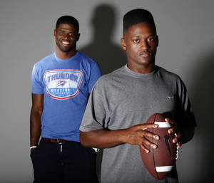 Photo - Carolina Panthers DB and former OU player Reggie Smith, left,  poses with his brother Trevan in the OPUBCO studios, Thursday, June 21, 2012. Photo by Sarah Phipps, The Oklahoman <strong>SARAH PHIPPS - SARAH PHIPPS</strong>