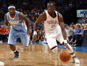 Photo - EXHIBITION NBA BASKETBALL GAME: Oklahoma City's Reggie Jackson (15) drives to the basket past Denver's Ty Lawson (3) during the NBA preseason basketball game between the Oklahoma City Thunder and the Denver Nuggets at the Chesapeake Energy Arena, Sunday, Oct. 21, 2012. Photo by Sarah Phipps, The Oklahoman