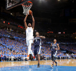 Photo - Oklahoma City's Kevin Durant (35) goes to the basket in front of Memphis' Tony Allen (9) and Mike Conley (11) during Game 1 in the first round of the NBA playoffs between the Oklahoma City Thunder and the Memphis Grizzlies at Chesapeake Energy Arena in Oklahoma City, Saturday, April 19, 2014. Photo by, Sarah Phipps, The Oklahoman