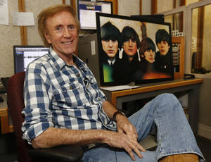 Photo - Broadcaster Ronnie Kaye discussed the Beatles U.S. debut 50 years ago during an interview at KOMA radio in Oklahoma City, Friday January 31, 2014. Photo By Steve Gooch, The Oklahoman