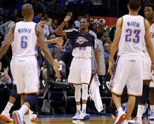 photo - Oklahoma City's Kevin Durant (35) celebrates during an NBA basketball game between the Oklahoma City Thunder and the Sacramento Kings at Chesapeake Energy Arena in Oklahoma City, Friday, Dec. 14, 2012. Photo by Bryan Terry, The Oklahoman