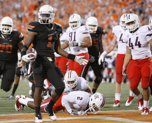 photo - Oklahoma State's Joseph Randle (1) scores a touchdown during a college football game between the Oklahoma State University Cowboys (OSU) and the University of Arizona Wildcats at Boone Pickens Stadium in Stillwater, Okla., Thursday, Sept. 8, 2011. Photo by Bryan Terry, The Oklahoman  ORG XMIT: KOD