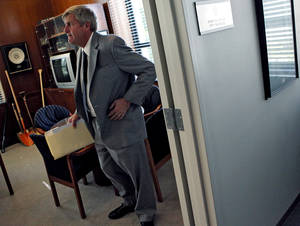Photo - Oklahoma City Manager Jim Couch gets ready to attend a meeting at City Hall in Oklahoma City on Wednesday, July 22, 2009. The Oklahoman Archives.