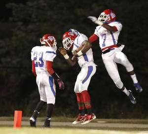 Photo - JM #23 Dez Jackson and #7 Devion Smith help #1 Keshawn Shells celebrate his long touchdown run during the high school football game of John Marshall at Star Spencer, Thursday, September 26, 2013. Photo by Doug Hoke, The Oklahoman