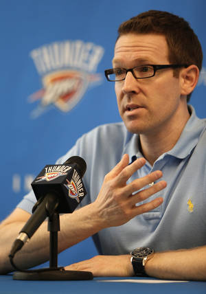 Photo - OKLAHOMA CITY THUNDER NBA BASKETBALL: Sam Presti, Oklahoma City general manager, speaks during a press conference announcing Scott Brook's new $16 million contract at the Integris Health Thunder Development Center in Oklahoma City, Tuesday, July 3, 2012.  Photo by Garett Fisbeck, The Oklahoman