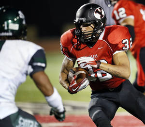 photo - Yukon's A.J. West (32) carries the ball during a high school football game between Yukon and Edmond Santa Fe in Yukon, Okla., Friday, Sept. 7, 2012. Photo by Nate Billings, The Oklahoman