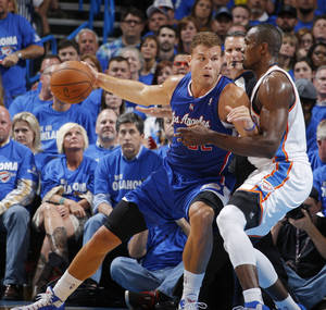 Photo -                    Blake Griffin, left, backs down against Serge Ibaka during Game 2.                     Photo by Bryan Terry, The Oklahoman