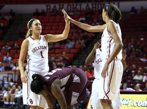 Photo - Oklahoma guard Nicole Kornet, left and Nicole Griffin, right, celebrate over Maryland Eastern Shore guard Mariah McCoy, center, after a play during the first half of an NCAA women's college basketball game in Norman, Okla., Sunday, Dec. 15, 2013. (AP Photo/Alonzo Adams)