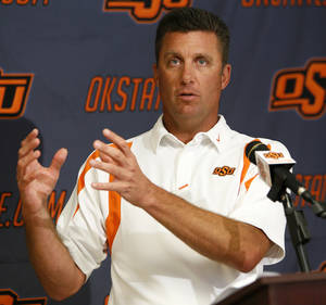 photo - OSU head coach Mike Gundy speaks to the media during Oklahoma State University football media availability at Boone Pickens Stadium in Stillwater, Okla., Thursday, Aug. 23, 2012. Photo by Nate Billings, The Oklahoman