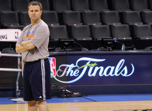Photo - Thunder coach Scott Brooks stands at mid court as he watches his players go through drills during the NBA Finals practice day at the Chesapeake Energy Arena on Monday, June 11, 2012, in Oklahoma City, Okla. Photo by Chris Landsberger, The Oklahoman