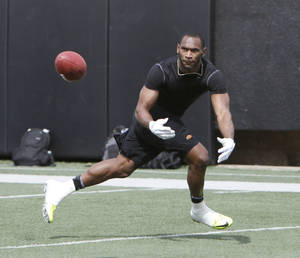 Photo - OSU's Joseph Randle is a versatile running back hoping to be taken in the NFL Draft.  By Paul Hellstern, The Oklahoman