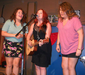 Photo - Audra Mae and her sisters at the Blue Door - Photo by Brandy McDonnell