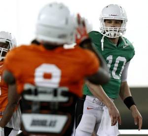 """Photo - Oklahoma State quarterback Mason Rudolph throws a pass during practice on Tuesday, April 1, 2014, at the outside fields of the Sherman E. Smith training facility of Oklahoma State University in Stillwater. The Cowboys' will hold """"Orange Blitz"""", an open practice that will replace the annual spring game this Saturday. Photo by KT King/For the Oklahoman"""