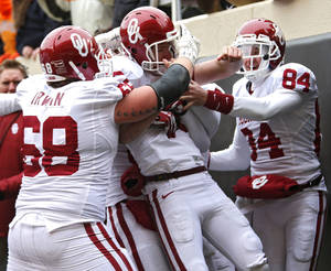 Photo - OU coach Bob Stoops said he made the call to go for a fake field goal which resulted in kicker Michael Hunnicutt's touchdown during Saturday's Bedlam victory against OSU. Photo by Chris Landsberger, The Oklahoman