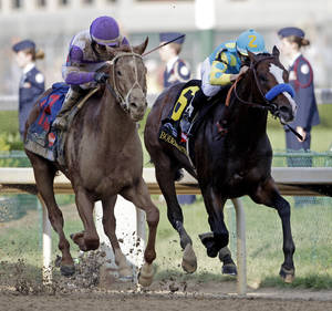 Photo - Jockey Mario Gutierrez rides I'll Have Another past Bodemeister ridden by Mike Smith (6) to victory in the 138th Kentucky Derby horse race at Churchill Downs Saturday, May 5, 2012, in Louisville, Ky. (AP Photo/Morry Gash)  ORG XMIT: DBY177