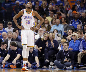 Photo - Oklahoma City Thunder's Kevin Durant (35) reacts to a turnover during the NBA basketball game between the Oklahoma City Thunder and the Utah Jazz at Chesapeake Energy Arena on Wednesday, March 13, 2013, in Oklahoma City, Okla. Photo by Chris Landsberger, The Oklahoman