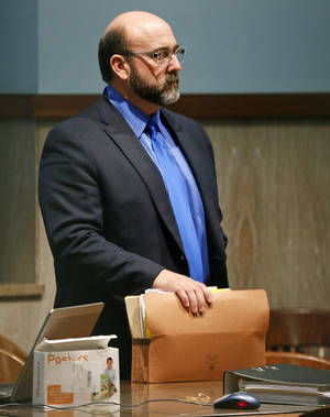 Photo - Del City police Capt. Randy Trent Harrison stands in the courtroom of Judge Donald Deason at the Oklahoma County courthouse on Friday. <strong>NATE BILLINGS - NATE BILLINGS</strong>