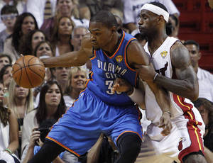 photo -   FILE - In this June 21, 2012, file photo,Oklahoma City Thunder small forward Kevin Durant (35) works the ball against Miami Heat small forward LeBron James (6) during the first half at Game 5 of the NBA finals basketball series in Miami. Durant and James will team-up for the USA in this summer's Olympics. (AP Photo/Lynne Sladky, File)