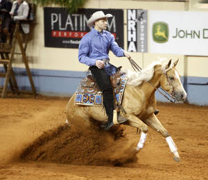 "photo - Todd Wright, of Newcastle, rides ""Steadyandsmart"" during the National Reining Horse Association show."