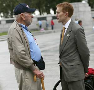 Photo - Rep. James Lankford, R-Oklahoma City, right, talks with Oklahoma veteran Charles Austin during a 2011 Honor Flight visit at the World War II Memorial in Washington. Oklahoman Archives <strong>JOHN CLANTON</strong>
