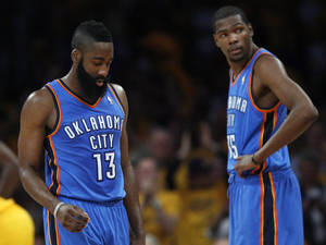 Photo - Oklahoma City's James Harden (13) and Kevin Durant (35) react during Game 3 in the second round of the NBA basketball playoffs between the L.A. Lakers and the Oklahoma City Thunder at the Staples Center in Los Angeles, Friday, May 18, 2012. Photo by Nate Billings, The Oklahoman