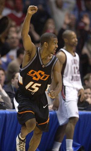 Photo - COLLEGE BASKETBALL, OSU, OKLAHOMA STATE UNIVERSITY:  Oklahoma State's John Lucas (15) reacts to scoring the winning 3-point shot as Saint Joseph's Tyrone Braley (12) looks on during second half game action at the NCAA Regional final in East Rutherford, N.J., Saturday, March 27, 2004. Oklahoma State defeated Saint Joseph's 64-62.  (AP Photo/Al Behrman)