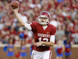 Photo - OU's Landry Jones (12) throws a pass during the college football game between the University of Oklahoma Sooners (OU) and the Kansas Jayhawks (KU) at Gaylord Family-Oklahoma Memorial Stadium in Norman, Okla., Saturday, Oct. 20, 2012. Photo by Bryan Terry, The Oklahoman