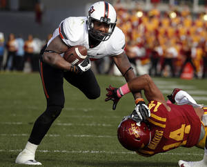 Photo - Oklahoma State 's Tracy Moore (87) gets by Iowa State's Jared Brackens (14) during the college football game between the Oklahoma State University (OSU) and Iowa State University (ISU) at Jack Trice Stadium in Ames, Iowa., Saturday, Oct. 26, 2013. Photo by Sarah Phipps, The Oklahoman