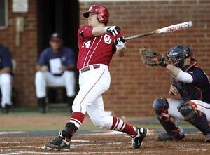 photo - UNIVERSITY OF OKLAHOMA / OU / NCAA TOURNAMENT / NCAA BASEBALL TOURNAMENT: Oklahoma's Matt Oberste (14) hits a home run in the second inning against Virginia during their NCAA college baseball regional game in Charlottesville, Va., Sunday, June 3, 2012. Oklahoma won 5-4. (AP Photo/The Daily Progress, Andrew Shurtleff) ORG XMIT: VACHA303