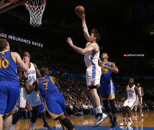 photo - Oklahoma City's Nick Collison (4) puts up a shot beside Golden State's Kent Bazemore (20) during an NBA basketball game between the Oklahoma City Thunder and the Golden State Warriors at Chesapeake Energy Arena in Oklahoma City, Wednesday, Feb. 6, 2013. Photo by Bryan Terry, The Oklahoman
