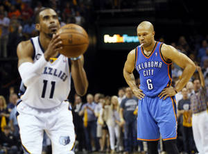 Photo - Oklahoma City's Derek Fisher (6) looks down as Memphis' Mike Conley (11) takes a foul shot in the final minute of Game 3 in the second round of the NBA basketball playoffs between the Oklahoma City Thunder and Memphis Grizzles at the FedExForum in Memphis, Tenn.,  Saturday, May 11, 2013. Memphis won, 87-81. Photo by Nate Billings, The Oklahoman