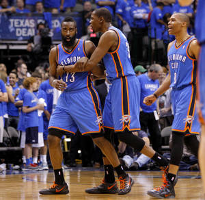 photo - Oklahoma City's James Harden (13), Kevin Durant (35), and Russell Westbrook celebrate during Game 4 of the first round in the NBA playoffs between the Oklahoma City Thunder and the Dallas Mavericks at American Airlines Center in Dallas, Saturday, May 5, 2012. Oklahoma City won 103-97. Photo by Bryan Terry, The Oklahoman