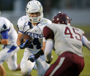 Photo - Mount St. Mary's Joe Castiglione Jr. runs beside Northeast's Gabriel Garcia during their high school football game at Douglass in Oklahoma City, Thursday, Sept. 19, 2013. Photo by Bryan Terry, The Oklahoman