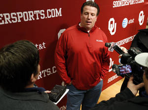 Photo - New University of Oklahoma (OU) offensive line coach Bill Bedenbaugh speaks with the media at his introductory press conference on Wednesday, Feb. 20, 2013 in Norman, Okla.  Photo by Steve Sisney, The Oklahoman