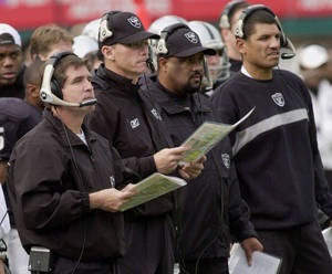 photo - Former Oakland Raiders coaches Bill Callahan, left, and offensive coordinator Marc Trestman, second from left, running backs coach Skip Peete, second from right, and tight ends coach Jay Norvell watch their team in 2003. Norvell denies recent allegations that the staff changed the game plan during the Super Bowl against Tampa Bay. AP photo