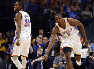 Photo - Oklahoma City's' Serge Ibaka (9) celebrates a three pointer with Kevin Durant (35) during the NBA game between the Oklahoma City Thunder and the Phoenix Suns at theChesapeake Energy Arena, Friday, Feb. 8, 2013.Photo by Sarah Phipps, The Oklahoman